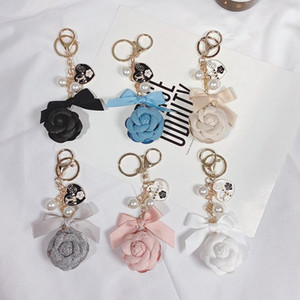 Creative handmade diy pearl chain double-sided camellia keychain female Korean fashion car key chain bag pendant