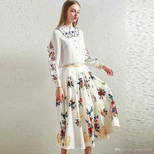 2020 Avrupa ve Amerikan High-end kadın 2020 Yeni Bebek Yaka Ahşap Kulak Uzun kollu Gömlek Ince Basınç Pileli Etek Takım Elbise Moda