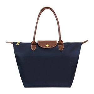 نايلون جديد شاطئ حقيبة أزياء المرأة حقيبة يد حمل أكسفورد حقائب الكتف الإناث ماء فطائر قابلة للطي حقيبة تسوق 2020