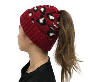 Epacket Delivery New leopard print jacquard ponytail knitted woollen hat for ladies with warm braid 5pcs lot Hats .