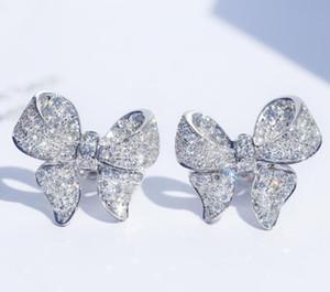 Diseñador plata esterlina arco encantador del perno prisionero cristalino brillante de lujo pendientes lindos CZ Diamond Stone joyería para las mujeres