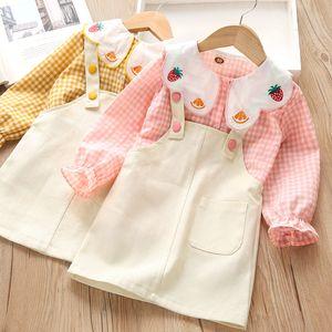 2020 Girls Baby Petal Collar Plaid Shirt + Strap Skirt Two Piece Suit Casual Comfortable Home Clothes Set Autumn Fashion Kids E090