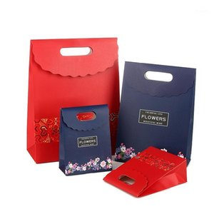 10pcs Red National Wind Paper Pouch Gift Flower Packaging Bags Wedding Christmas Gift Bag With Holes1