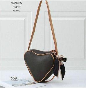 TG3074-6 # حقائب أزياء السيدات الشهيرة حقيبة الكتف حقيبة رسول حقيبة تسوق حقيبة يد مصنف على شكل قلب شحن مجاني 27x10x20 سنتيمتر