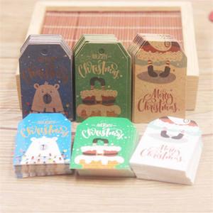 100pcs 5 * 3 cm Merry Christmas Etiketler Kraft Kağıt Kart Hediye Etiket Etiket DIY asın Etiketler Hediye Paketleme Dekor Hediye Kartı AHA1580