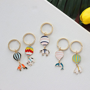Sansummer New Style Fashionable Cartoon Animals Dolphins Fox Polar Bear Cow Hot Air Balloon Keychain Cute Pendant 6418