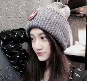 La qualità di Hight donne uomo autunno inverno tappo oca sport casuali maglia cappello da sci papaline beanie all'aperto Gorro ugea calda lana Cappello di lana unisex