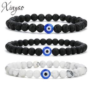 Xinyao Trendy Mal Bracelet à breloques yeux pour les femmes réglable Lava Pierre Couleur Noir Blanc Perles Bracelet Bangles Bijoux