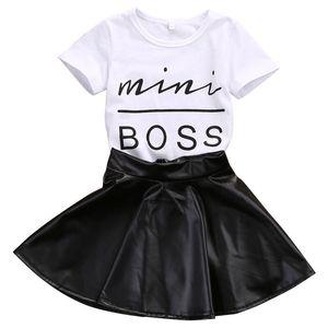 Новая мода малышей дети девушка одежда набор летние короткие рукава мини-босс футболку топы + кожаные юбка 2шт наряд ребенка дизайнерский костюм