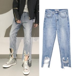 Spring new kind of new alternative foot mouth big break hole denim jeans pants man small straight leg jeans pants.
