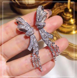 فاخر براق أزياء القوس مصمم أقراط طويل الشرابة استرخى مجوهرات أقراط مع كريستال CZ الماس حجر للمرأة الزفاف