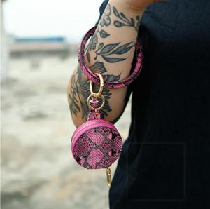 2020 Trendy Leather Tassel Snakeskin Earphone Bag Wristlet Keychains