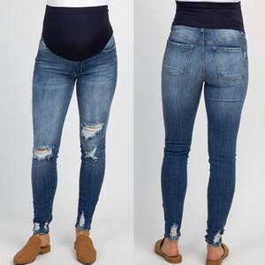 Primavera e no Outono novo estilo perfurado calças jeans femininas Grávida de denim das mulheres grávidas