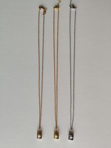 Designer de luxo jóias mulheres colar de ouro bloqueio pingente desenhador colar para homens elegante colar de cadeia de prata e brinquedos braceletes terno