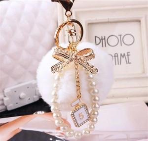 2020 Fashion Pearl Chain Crystal Bottle Bow Pompom Keychain Car Women Handbag Key Chain Ring Fluffy Puff Bal jllRab ffshop2001