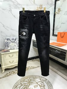 QTW319129 2020 High quality Mens jeans Distressed Motorcycle biker jeans Rock Ripped hole stripe Fashionable pants