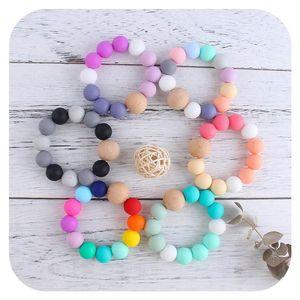 2021 Neue DIY Baby Silikon Kinderkrankheiten Perlen Neugeborenen Kinderkrankheiten Ring Kind Holz Ring Zähne Baby Spielzeug Bunte Silikon Perlen Schnuller