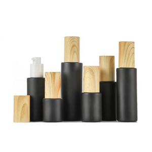 pompa bottiglie di vetro vuote ricaricabili nero smerigliato lozione bottiglie di vetro essenziale bottiglia di olio spray con venatura del legno DWC2966 plastica tappo