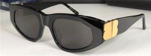Hombres Gafas de sol Diseño de moda Eyewear 0095 Cat Eye Mark Style Top Calidad UV400 Gafas protectores con caja negra