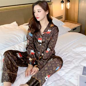 Fashion Nouveau couple d'impression Couple de sommeil Soie Satin Satin Pyjamas Ensemble de boutonnage à manches longues Pajamas costume Pijama Femmes hommes Plus Taille PJ Ensemble H1210