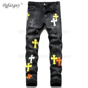 Nuevo medalla de cruce bordada europea y estadounidense pequeños Pantalones vaqueros de micro estiramiento de hombres heterosexuales de moda para hombre de moda Pantalones de diseño