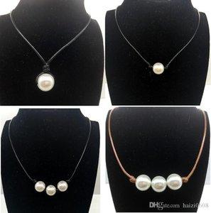 Женщины Мода жемчужное ожерелье ювелирных изделий White Pearl Black Leather Rope шнур Choker ожерелье Choker Слип Узел Имитация пресной воды Pearl Новые
