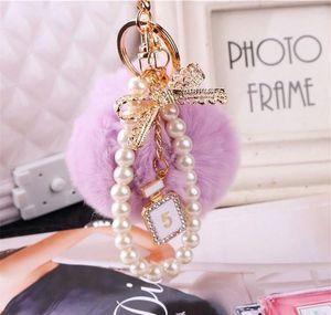 2020 Fashion Pearl Chain Crystal Bottle Bow Pompom Keychain Car Women Handbag Key Chain Ring Fluffy Puff Ball Keychains Jewelry 7Bq9L
