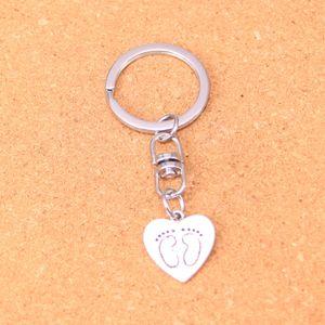 Fashion Keychain 19*18mm heart foot prints Pendants DIY Jewelry Car Key Chain Ring Holder Souvenir For Gift