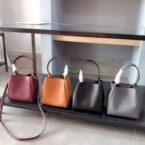 Designer conçu vachette marque de haute qualité déformable sac seau sac à main, taille: 18cm * 19cm * 10cm.