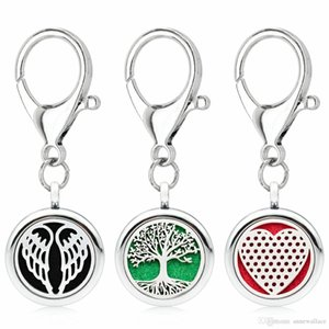 Prata Essencial 25 milímetros Oil Difusor Keychain Diy Aroma Locket Tree Of Life Lotus chave Anel Fit Pet 5pcs Collar Pads