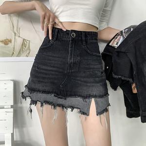 Fall 2020 new fashion brand broken hole high waist A-line buttock fake two pieces of raw hem denim skirt women's skirt