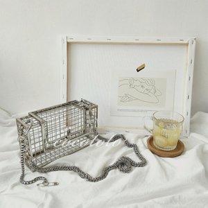 Дизайнер-INS выдалбливают сцепления сумка Bird Cage Женщины сумки Tote Metal Кейдж Девушки Топ-ручки сумки кошелек партии способа мешок мешок вечера