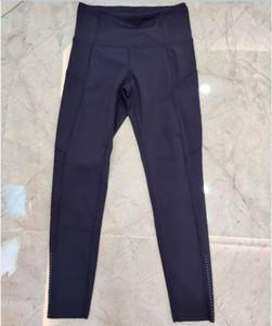 Pantalones de yoga de cintura alta caliente Capri con 3 bolsillos, entrenamiento de control de la barriga funcionando Capri 4 Way Stretch Yoga Leggings