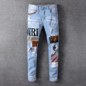 Nuevos jeans para hombre de alta calidad Motocicleta angustiada Motocicleta Jeans Rock Skinny Slim Ripped Hole Letra Top Calidad Marca Denim Jeans