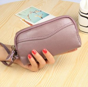 The new leather leather bag of the European and American fashion mobile phone bag double zipper lady hand bag zero purse.
