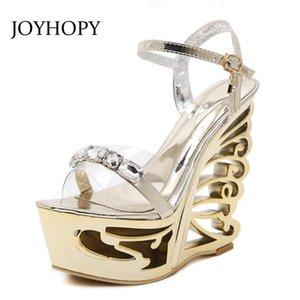 Joyhopy الصيف موضة جديدة الكاحل التفاف الصنادل WOWEين الديكور المعادن الجوف خارج نمط غريب عالية الكعب حزب أحذية WS1680