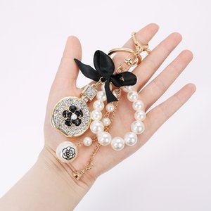 Black Enamel Camellia Keychain Women Men Jewelry Crystal Perfume Bottle Tassel Pearl Tower Key Ring Car Accessories Z121