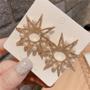 S925 moda aguja de plata geométricas pendientes exageradas sentido de gama alta con diamantes de la perla pendientes estrella de ocho puntas de sol femeninas