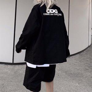 marca na moda nova chuanjiubaoling PLAY-CDG imprimiram a camisa casal polo dos homens e meninas