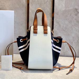 Les derniers sacs de mode de mode de style marine de la marine enveloppé épissage de vachette 00950 Les deux côtés sont conçus pour dessiner la corde commode pour de nombreuses