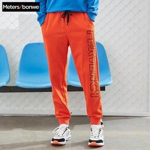 Metersbonwe Men Красивые спортивные брюки Новая Весна Осень Письмо Печать Луч Ноги Безвозмездная Брюки Мода Спорт Мужской Брюки Брюки X1116
