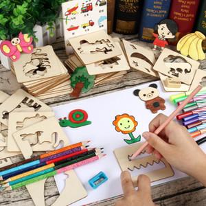 100pcs Conseil scolaire Peinture Peinture Outils Modèles Stencil Coloring Board Enfants Creative Doodles Apprentissage Education Toy 201014
