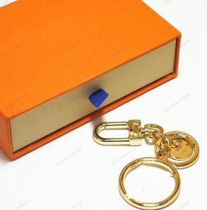 Designer Gold Lettre Keychain Mode Unisexe KeyRing Metal Cartoon Lettre Fleur Pendentif Car Chaîne de voiture Charme Accessoires de bibelot Cadeaux