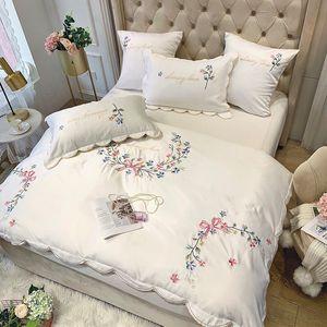 Francés algodón de seda del hielo bordado del estilo del lujo luz cuatro piezas funda de edredón de estilo europeo blanca ropa de cama de algodón de comercio exterior juego de cama