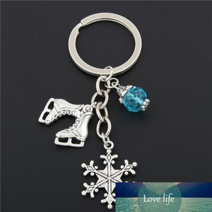 1 قطعة كيرينغ الثلج مع الأزرق حبة مفتاح سلسلة المفاتيح مجوهرات فضة اللون شفرات الجليد سحر الزلاجات قلادة الشتاء مجوهرات E1672