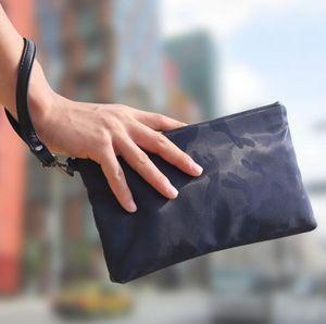 wholesale men handbag portable waterproof Oxford fashion wrist bag multifunctional camouflage mobile phone bag outdoor leisure storage walle
