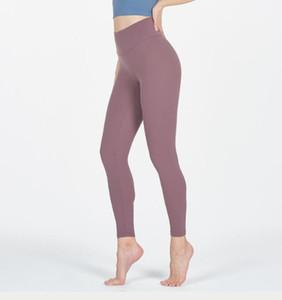 Ropa de los pantalones de la yoga de nuevo estilo de las mujeres corrientes de los deportes de fitness que adelgaza las nalgas pantalones de los pies de color puro