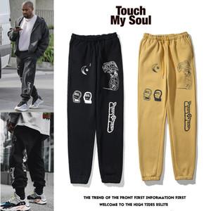 marque pieds lâches marée graffiti pantalons européens et américains Kanye hommes automne et d'hiver, plus velours sport tout-match pantalons décontractés pour moi