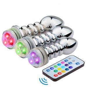 Anal Gay Ligth JJD2228 Stpkr Uzaktan Kablosuz Metal Kadınlar Anal Plug Plug Butt Butt plug seks Oyuncaklar LED LED uyarmak