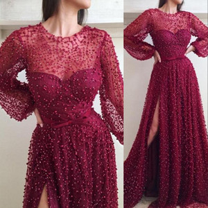 2020 New Sexy Red Evening Dresses Wear Jewel Neck Illusion Lace Pearls Major Beading Long Sleeves Side Split Plus Size Party Prom Gowns